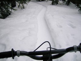 Biking on a snowy singletrack, fernie, bc, canada