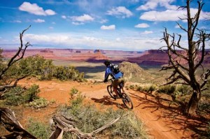 rider flowingdown the porcupine rim tail in moab utah, usa