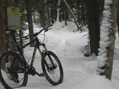 at the trail head of a sweet, snow packed, bike trail