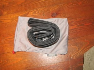 a spare inner tube (presta) inside a goggle bag