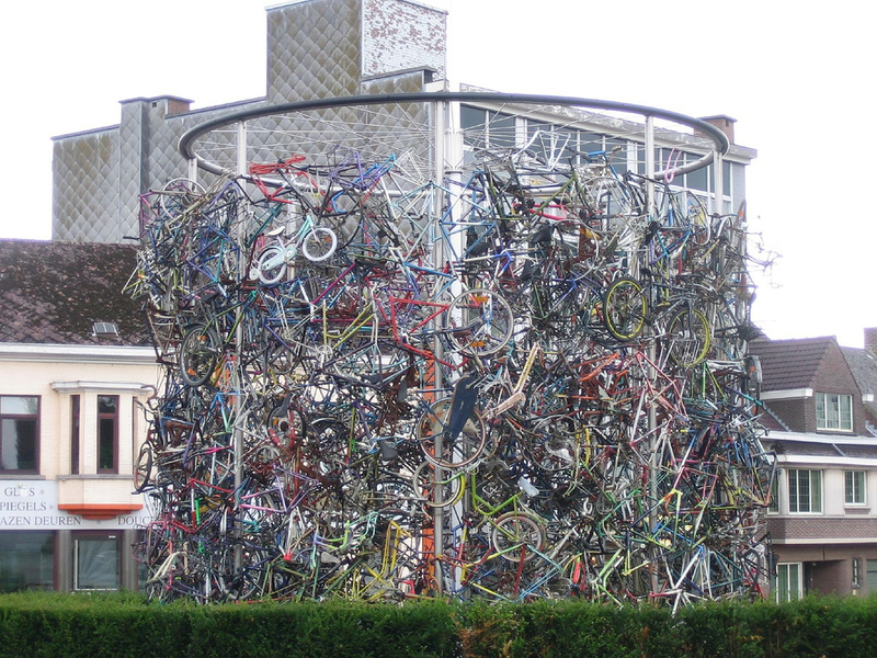sculpture of bicycles in a traffic circle in brakel, belgium